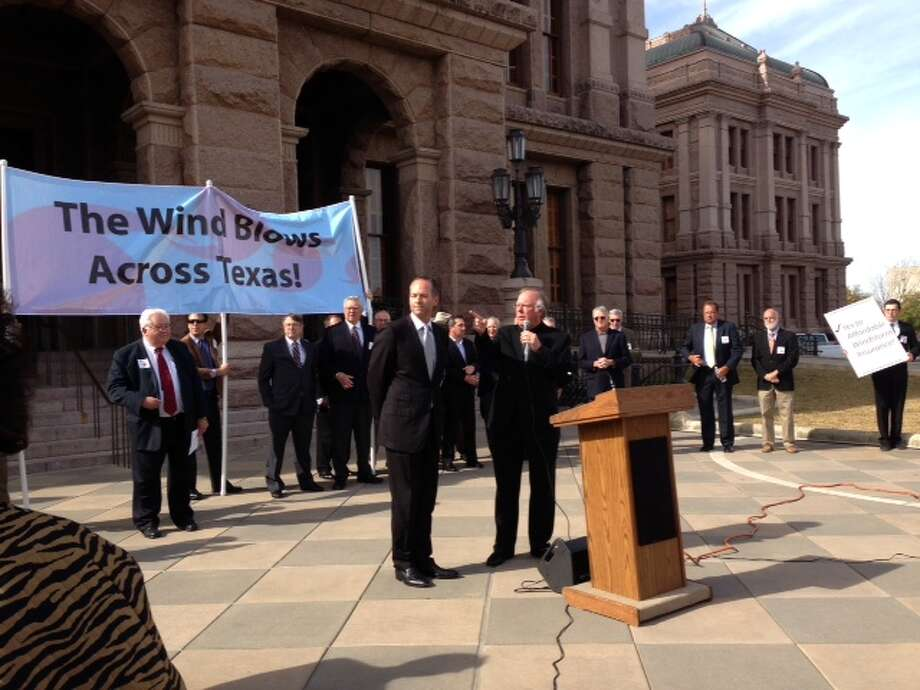 State Rep. Craig Eiland, D-Galveston, left; and state Rep. Todd Hunter, R-Corpus Christi, address Texas coastal residents at the state capitol in Austin at a rally for windstorm insurance reform on Tuesday. Courtesy photo from the Greater Beaumont Chamber of Commerce Photo: Courtesy Photo