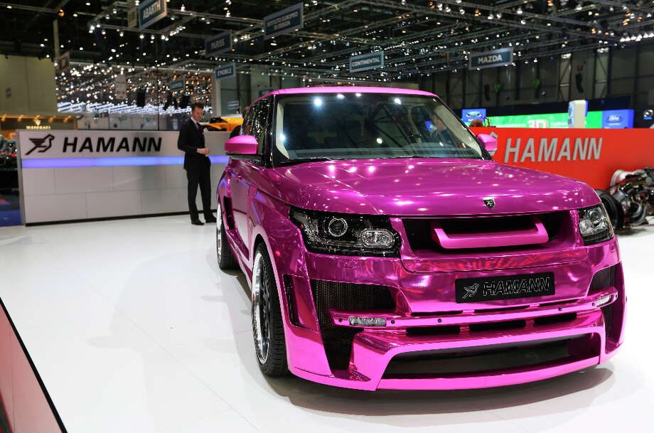 A purple Range Rover automobile customized by Hamann is seen on display on the first day of the 83rd Geneva International Motor Show in Geneva, Switzerland, on Tuesday, March 5, 2013. This year's show opens to the public on Mar. 7, and is set to feature more than 100 product premiers from the world's automobile manufacturers. Photographer: Chris Ratcliffe/Bloomberg Photo: Chris Ratcliffe, Bloomberg / Copyright 2013 Bloomberg Finance LP, All Rights Reserved.
