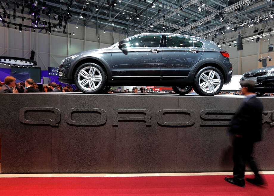 A Qoros 3 concept hybrid cross automobile, produced by Qoros Auto Co., a joint venture between Chery Automobile Co. and Israel Corp., is seen on display on the first day of the 83rd Geneva International Motor Show in Geneva, Switzerland, on Tuesday, March 5, 2013. This year's show opens to the public on Mar. 7, and is set to feature more than 100 product premiers from the world's automobile manufacturers. Photographer: Valentin Flauraud/Bloomberg Photo: Valentin Flauraud, Bloomberg / Copyright 2013 Bloomberg Finance LP, All Rights Reserved.