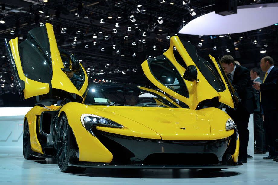 The new McLaren P1 is displayed in World premiere at the Geneva International Motor Show on March 5, 2013 which opens its doors today under a dark cloud, with no sign of a speedy rebound in sight for the troubled European market. The event, which is considered one of the most important car shows of the year, will again be heavily marked by the crisis in Europe after an already catastrophic year in 2012. AFP PHOTO / SEBASTIEN FEVALSEBASTIEN FEVAL/AFP/Getty Images Photo: SEBASTIEN FEVAL, AFP/Getty Images / AFP