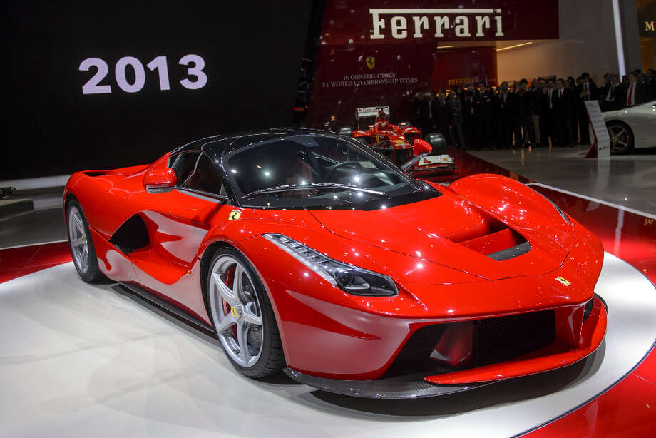 The new La Ferrari hybrid model car is unveilled in World premiere at Italian car maker's booth during the 83rd Geneva Motor Show on March 5, 2013. The Geneva International Motor Show opens its doors under a dark cloud, with no sign of a speedy rebound in sight for the troubled European market. The event, which is considered one of the most important car shows of the year, will again be heavily marked by the crisis in Europe after an already catastrophic year in 2012. AFP PHOTO / FABRICE COFFRINIFABRICE COFFRINI/AFP/Getty Images Photo: FABRICE COFFRINI, AFP/Getty Images / AFP