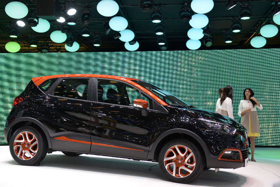 The new Renault Captur is displayed in World premiere at the French carmaker's booth on March 5, 2013 on the press day of the Geneva car Show in Geneva. The Geneva International Motor Show opens its doors under a dark cloud, with no sign of a speedy rebound in sight for the troubled European market. The event, which is considered one of the most important car shows of the year, will again be heavily marked by the crisis in Europe after an already catastrophic year in 2012.  AFP PHOTO / SEBASTIEN FEVALSEBASTIEN FEVAL/AFP/Getty Images Photo: SEBASTIEN FEVAL, AFP/Getty Images / AFP