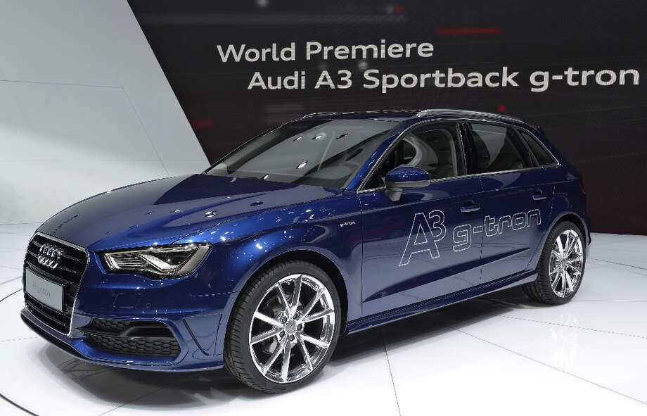 The new Audi A3 Sportback is displayed in World premiere at the German carmaker's booth on March 5, 2013 on the press day of the Geneva car Show in Geneva.  The Geneva International Motor Show opened its doors to the press under a dark cloud, with no sign of a speedy rebound in sight for the troubled European market. The event, which is considered one of the most important car shows of the year, will again be heavily marked by the crisis in Europe after an already catastrophic year in 2012.  AFP PHOTO / SEBASTIEN FEVALSEBASTIEN FEVAL/AFP/Getty Images Photo: SEBASTIEN FEVAL, AFP/Getty Images / AFP