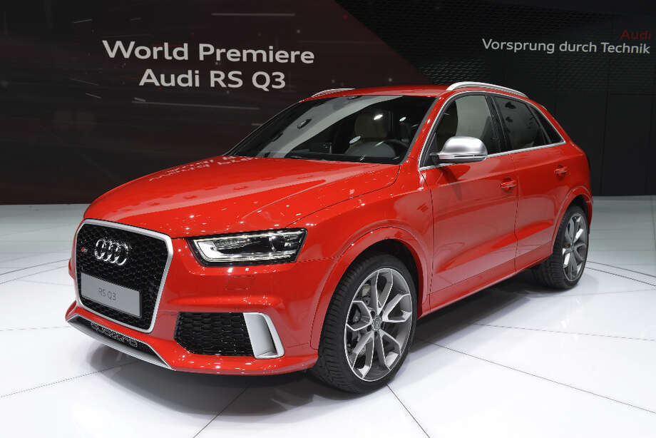 The new Audi RS Q3 is displayed in World premiere at the German carmaker's booth on March 5, 2013 on the press day of the Geneva car Show in Geneva. The Geneva International Motor Show opened its doors to the press under a dark cloud, with no sign of a speedy rebound in sight for the troubled European market. The event, which is considered one of the most important car shows of the year, will again be heavily marked by the crisis in Europe after an already catastrophic year in 2012.  AFP PHOTO / SEBASTIEN FEVALSEBASTIEN FEVAL/AFP/Getty Images Photo: SEBASTIEN FEVAL, AFP/Getty Images / AFP