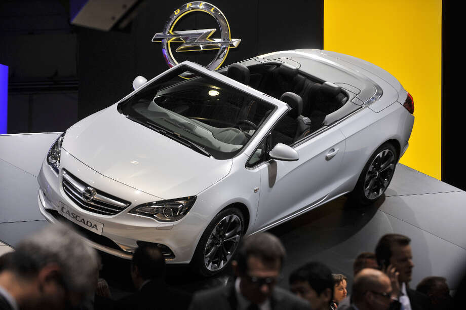 The new Opel Cascada Cabriolet is displayed in World premiere at the German carmaker's booth on March 5, 2013 on the press day of the Geneva car Show in Geneva. The Geneva International Motor Show opened its doors to the press under a dark cloud, with no sign of a speedy rebound in sight for the troubled European market. The event, which is considered one of the most important car shows of the year, will again be heavily marked by the crisis in Europe after an already catastrophic year in 2012.  AFP PHOTO / SEBASTIEN FEVALSEBASTIEN FEVAL/AFP/Getty Images Photo: SEBASTIEN FEVAL, AFP/Getty Images / SEBASTIEN FEVAL