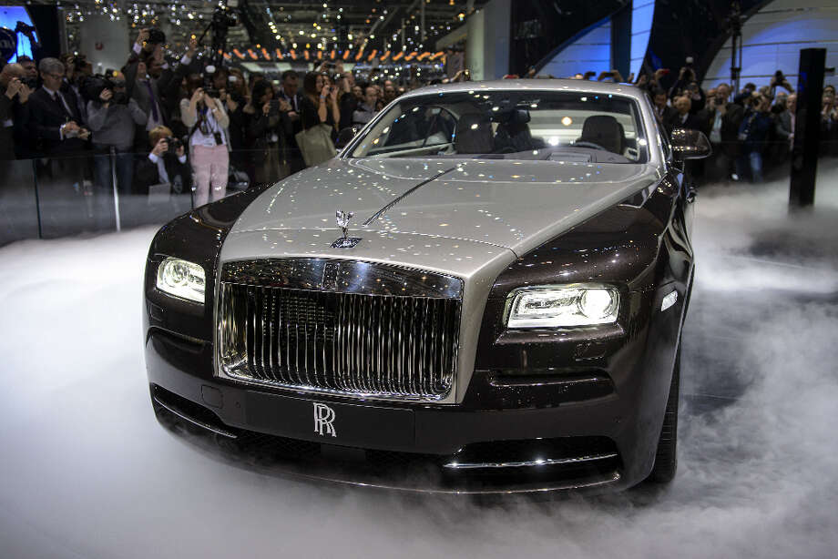 The new Rolls Royce the Wraith model car is presented in world premiere at the British car maker's booth on March 5, 2013 on the press day of the Geneva car Show in Geneva. The Geneva International Motor Show opened its doors to the press under a dark cloud, with no sign of a speedy rebound in sight for the troubled European market. The event, which is considered one of the most important car shows of the year, will again be heavily marked by the crisis in Europe after an already catastrophic year in 2012.   FABRICE COFFRINI/AFP/Getty Images Photo: FABRICE COFFRINI, AFP/Getty Images / AFP
