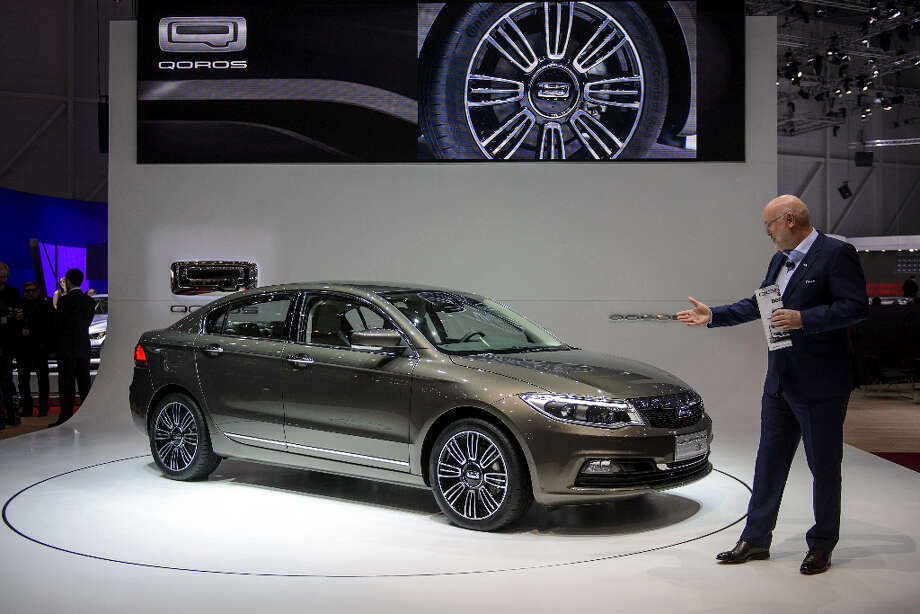 A Qoros 3 Sedan is displayed as a European premiere at the Chinese car maker's booth during the 83rd Geneva Motor Show on March 5, 2013 on the press day of the Geneva car Show in Geneva.  The Geneva International Motor Show opened its doors to the press under a dark cloud, with no sign of a speedy rebound in sight for the troubled European market. The event, which is considered one of the most important car shows of the year, will again be heavily marked by the crisis in Europe after an already catastrophic year in 2012.  AFP PHOTO / FABRICE COFFRINIFABRICE COFFRINI/AFP/Getty Images Photo: FABRICE COFFRINI, AFP/Getty Images / AFP