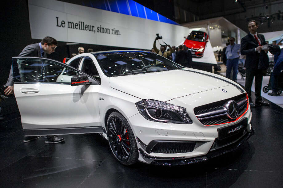 The new Mercedes Benz A 45 AMG edition is displayed in World Premiere at the German car maker's booth during the 83rd Geneva Motor Show on March 5, 2013 in Geneva. The Geneva International Motor Show opened its doors to the press under a dark cloud, with no sign of a speedy rebound in sight for the troubled European market. The event, which is considered one of the most important car shows of the year, will again be heavily marked by the crisis in Europe after an already catastrophic year in 2012. AFP PHOTO/FABRICE COFFRINIFABRICE COFFRINI/AFP/Getty Images Photo: FABRICE COFFRINI, AFP/Getty Images / AFP