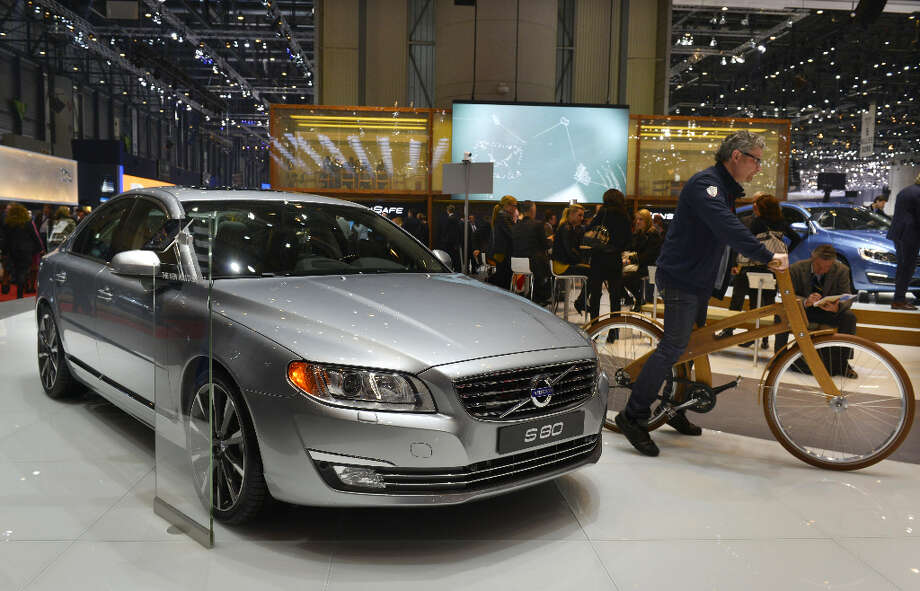 The new Volvo S80 is displayed in World premiere at the Swedish carmaker's booth on March 5, 2013 on the press day of the Geneva car Show in Geneva. The Geneva International Motor Show opened its doors to the press under a dark cloud, with no sign of a speedy rebound in sight for the troubled European market. The event, which is considered one of the most important car shows of the year, will again be heavily marked by the crisis in Europe after an already catastrophic year in 2012. AFP PHOTO / SEBASTIEN FEVALSEBASTIEN FEVAL/AFP/Getty Images Photo: SEBASTIEN FEVAL, AFP/Getty Images / AFP
