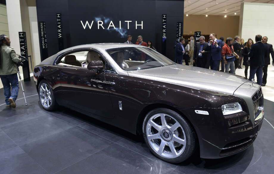 The new Rolls Royce Wraith is displayed in World premiere at the British carmaker's booth on March 5, 2013 on the press day of the Geneva car Show in Geneva. The Geneva International Motor Show opened its doors to the press under a dark cloud, with no sign of a speedy rebound in sight for the troubled European market. The event, which is considered one of the most important car shows of the year, will again be heavily marked by the crisis in Europe after an already catastrophic year in 2012. AFP PHOTO / SEBASTIEN FEVALSEBASTIEN FEVAL/AFP/Getty Images Photo: SEBASTIEN FEVAL, AFP/Getty Images / AFP