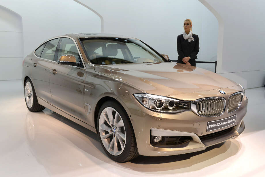 The new BWM  328i Gran Turismo is displayed in World premiere at the German carmaker's booth on March 5, 2013 on the press day of the Geneva car Show in Geneva. The Geneva International Motor Show opened its doors to the press under a dark cloud, with no sign of a speedy rebound in sight for the troubled European market. The event, which is considered one of the most important car shows of the year, will again be heavily marked by the crisis in Europe after an already catastrophic year in 2012. AFP PHOTO / SEBASTIEN FEVALSEBASTIEN FEVAL/AFP/Getty Images Photo: SEBASTIEN FEVAL, AFP/Getty Images / AFP