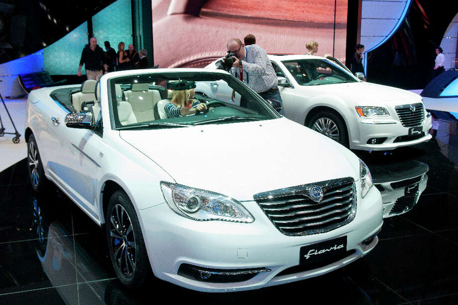 The new Lancia Flavia is shown during the press day at the 82nd Geneva International Motor Show in Geneva, Switzerland, Tuesday, March 6, 2012. The Motor Show will open its gates to the public from March 8 to 18, presenting more than 260 exhibitors and more than 180 world and European premieres. (AP Photo/Keystone, Sandro Campardo) Photo: Sandro Campardo, Associated Press / KEYSTONE
