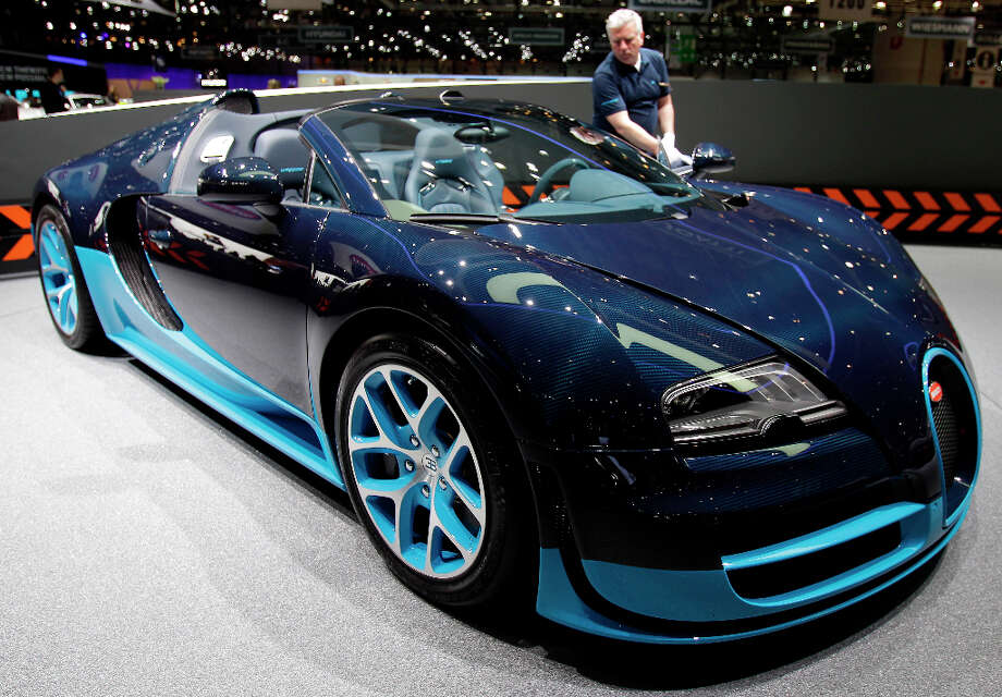 The Bugatti Vitesse is on display on  Wednesday, March 7, 2012 during the press preview days at the 82nd Geneva International Motor Show in Geneva, Switzerland. The Motor Show will open it's doors to public from the  8th to the 18th of March presenting more than 260 exhibitors and more than 180 world and European premieres. (AP Photo/Frank Augstein) Photo: Frank Augstein, Associated Press / AP