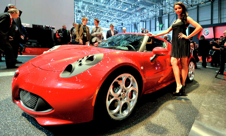 An Alfa Romeo 4C is shown during the press day at the 83rd Geneva International Motor Show in Geneva, Switzerland, Tuesday, March 5, 2013. The Motor Show will open its gates to the public from 7th to 17th March presenting more than 260 exhibitors and more than 130 world and European premieres. (AP Photo/Keystone, Photopress/Christian Brun) Photo: CHRISTIAN BRUN, Associated Press / Keystone