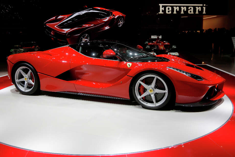 The new Ferrari, named LaFerrari, is presented during the first media day of the 83rd Geneva International Motor Show, Switzerland, Tuesday, March 5, 2013. The Motor Show will open its gates to the public from March 7 to 17.  (AP Photo/Laurent Cipriani) Photo: Laurent Cipriani, Associated Press / AP