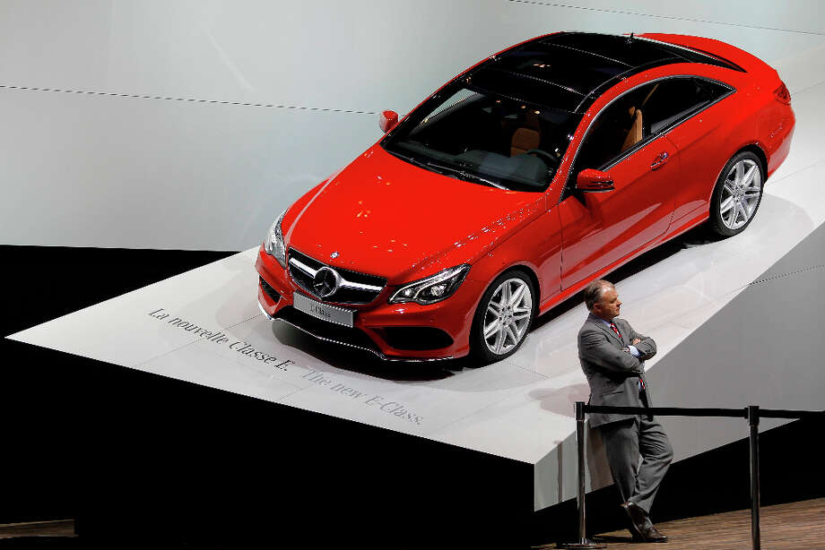A man stands in front of the Mercedes E-Class during the first media day of the 83rd Geneva International Motor Show, Switzerland, Tuesday, March 5, 2013. The Motor Show will open its gates to the public from March 7 to 17.  (AP Photo/Laurent Cipriani) Photo: Laurent Cipriani, Associated Press / AP