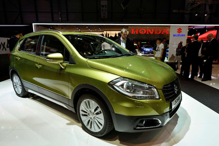 The new Suzuki SX4 S-Cross is shown during the press day at the 83rd Geneva International Motor Show in Geneva, Switzerland, Tuesday, March 5, 2013. The Motor Show will open its gates to the public from 7th to 17th March presenting more than 260 exhibitors and more than 130 world and European premieres. (AP Photo/Keystone, Martial Trezzini) Photo: Martial Trezzini, Associated Press / Keystone