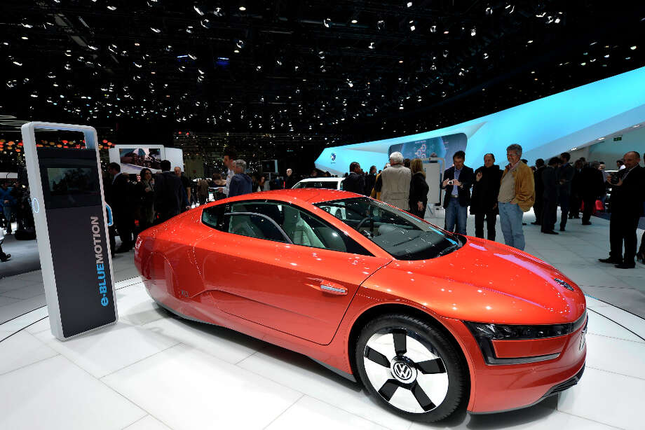 The new Volkswagen VW Prototype XL1 is shown during the press day at the 83rd Geneva International Motor Show in Geneva, Switzerland, Tuesday, March 5, 2013. The Motor Show will open its gates to the public from 7th to 17th March presenting more than 260 exhibitors and more than 130 world and European premieres. (AP Photo/Keystone, Martial Trezzini) Photo: Martial Trezzini, Associated Press / Keystone