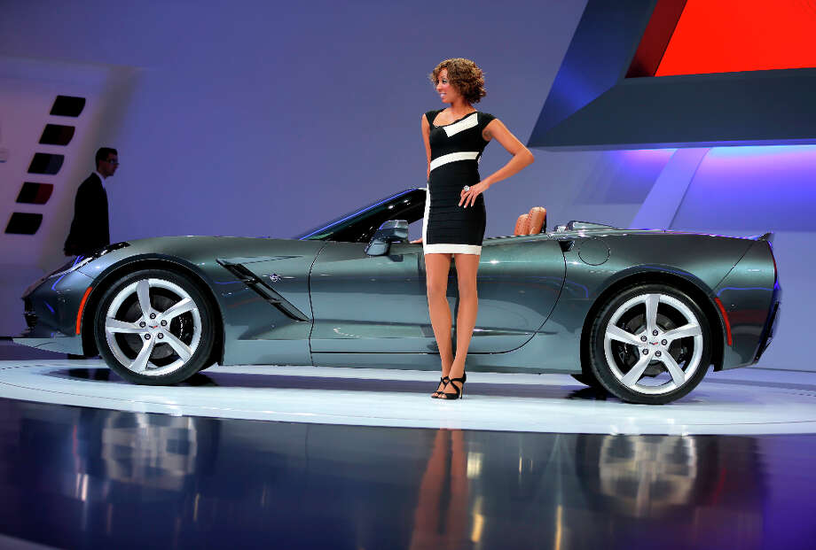 A female model stands alongside a Chevrolet Corvette Stingray automobile, produced by General Motors Co. (GM), on the first day of the 83rd Geneva International Motor Show in Geneva, Switzerland, on Tuesday, March 5, 2013. This year's show opens to the public on Mar. 7, and is set to feature more than 100 product premiers from the world's automobile manufacturers. Photographer: Valentin Flauraud/Bloomberg Photo: Valentin Flauraud, Bloomberg / Copyright 2013 Bloomberg Finance LP, All Rights Reserved.