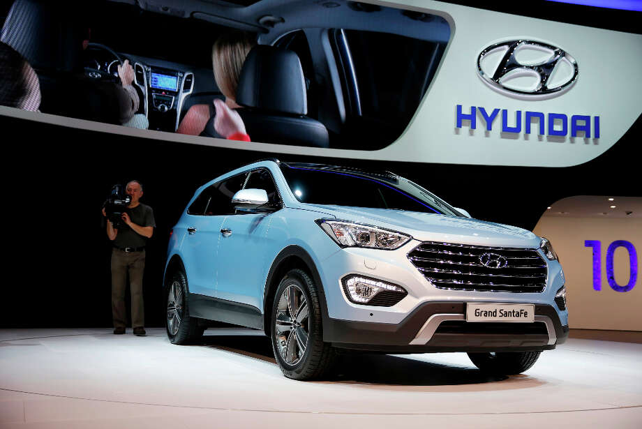 A Hyundai Grand Santa Fe automobile, produced by Hyundai Motor Co., is seen on display on the first day of the 83rd Geneva International Motor Show in Geneva, Switzerland, on Tuesday, March 5, 2013. This year's show opens to the public on Mar. 7, and is set to feature more than 100 product premiers from the world's automobile manufacturers. Photographer: Valentin Flauraud/Bloomberg Photo: Valentin Flauraud, Bloomberg / Copyright 2013 Bloomberg Finance LP, All Rights Reserved.