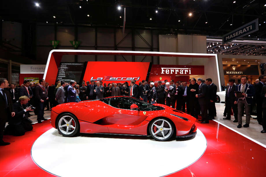 The new Ferrari La Ferrari (F150) automobile, produced by Ferrari SpA, is launched on the first day of the 83rd Geneva International Motor Show in Geneva, Switzerland, on Tuesday, March 5, 2013. This year's show opens to the public on Mar. 7, and is set to feature more than 100 product premiers from the world's automobile manufacturers. Photographer: Chris Ratcliffe/Bloomberg Photo: Chris Ratcliffe, Bloomberg / Copyright 2013 Bloomberg Finance LP, All Rights Reserved.