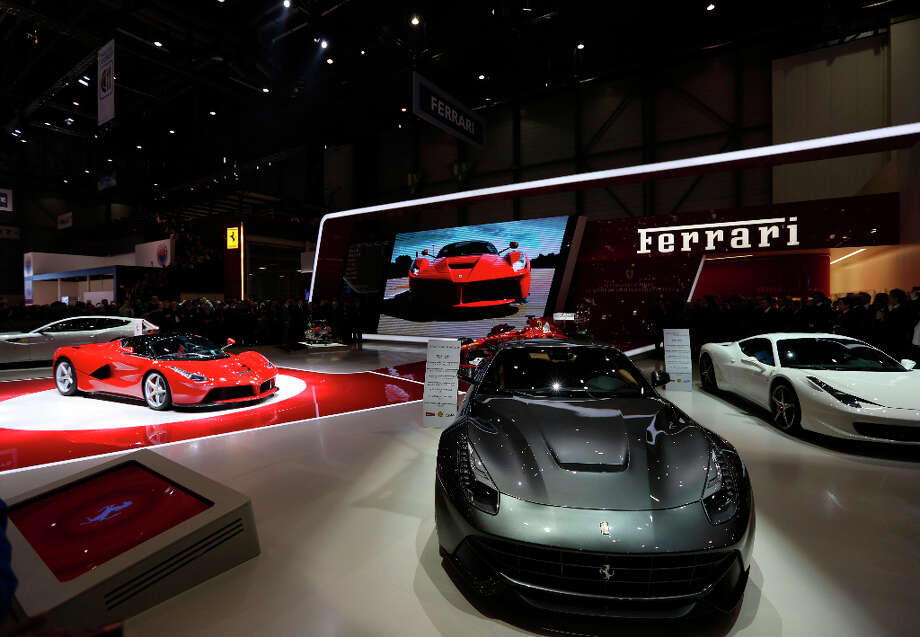 The new Ferrari La Ferrari (F150) automobile, produced by Ferrari SpA, left, sits on the company's stand on the first day of the 83rd Geneva International Motor Show in Geneva, Switzerland, on Tuesday, March 5, 2013. This year's show opens to the public on Mar. 7, and is set to feature more than 100 product premiers from the world's automobile manufacturers. Photographer: Chris Ratcliffe/Bloomberg Photo: Chris Ratcliffe, Bloomberg / Copyright 2013 Bloomberg Finance LP, All Rights Reserved.