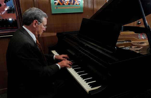 Lamar President Jimmy Simmons plays on the baby grand piano in his office. Photo taken February 5, 2013 Guiseppe Barranco/The Enterprise Photo: Guiseppe Barranco, STAFF PHOTOGRAPHER / The Beaumont Enterprise