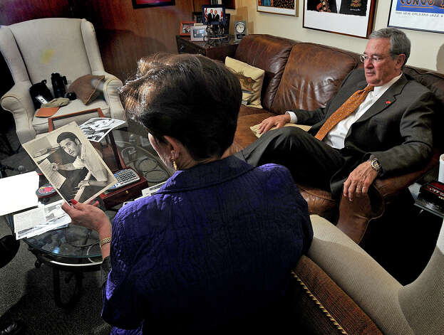 Susan Simmons looks at an archived picture of her husband Jimmy SImmons in his office. Photo taken February 5, 2013 Guiseppe Barranco/The Enterprise Photo: Guiseppe Barranco, STAFF PHOTOGRAPHER / The Beaumont Enterprise