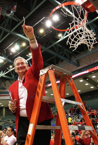 Lamar president Jimmy Simmons holds up a piece of the net after Lamar's 70-49 win over McNeese in the SLC Championship Game in the Merrell Center in Katy. Matt Billiot for The Enterprise. Photo: Matt Billiot