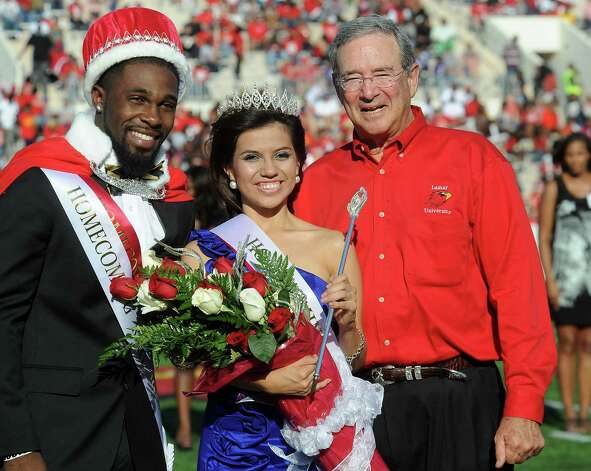 Homecoming King, Darius Miller, Homecoming Queen, Tanya Leon, and Lamar President, Jimmy Simmons pose for photos during halftime of the homecoming game against Central Arkansas at the Provost Umphrey Stadium at Lamar in Beaumont, Saturday, October 22, 2011. Tammy McKinley/The Enterprise Photo: TAMMY MCKINLEY