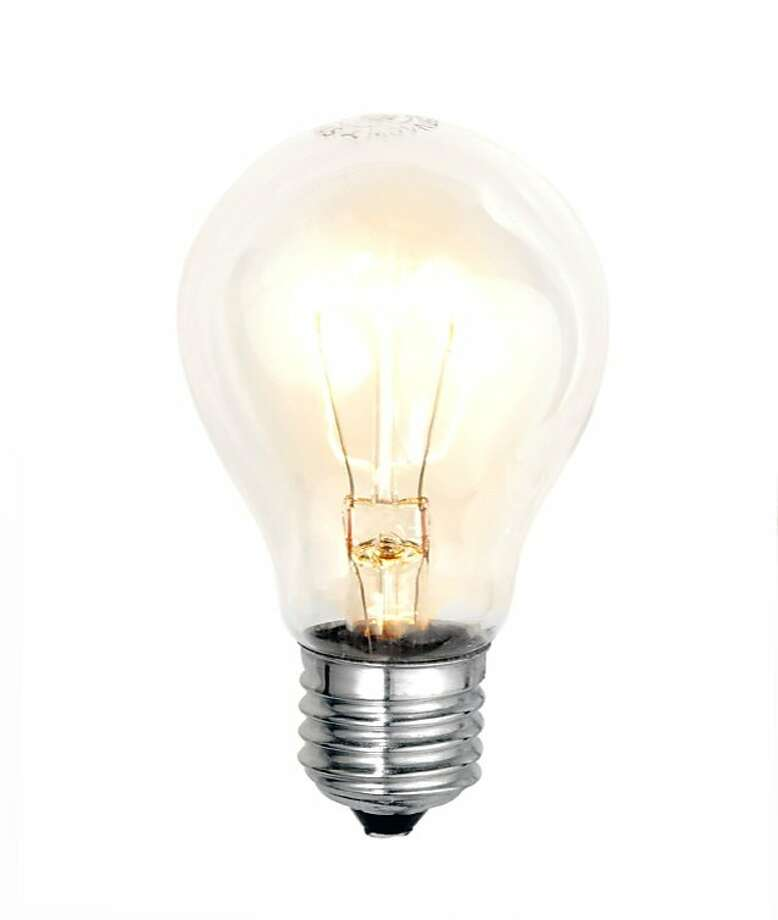 Traditional incandescent light bulbs, like this one that uses a wire filament, will be phased out of being sold in California starting Jan. 1. Photo: IStockphoto.com