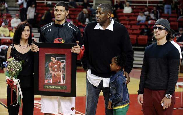 Lamar player Nikko Acosta is honored on Lamar University Senior Day before their game against Oral Roberts University on Saturday, March 2, 2013. Photo taken: Randy Edwards/The Enterprise
