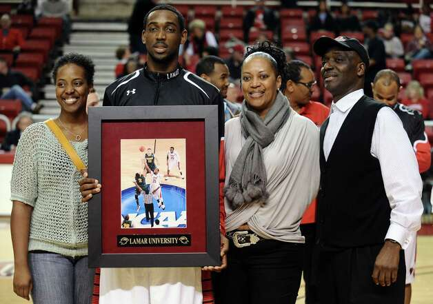Lamar player Stan Brown is honored on Lamar University Senior Day before their game against Oral Roberts University on Saturday, March 2, 2013. Photo taken: Randy Edwards/The Enterprise