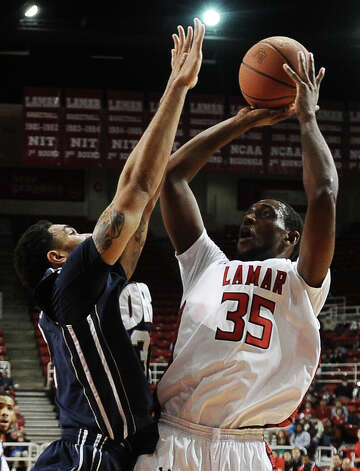 Lamar player Stan Brown, #35, puts it up for two during the Lamar University mens basketball game against Oral Roberts University at the Montagne Center on March 2, 2013.  Oral Roberts won over Lamar 68 - 50. Photo taken: Randy Edwards/The Enterprise