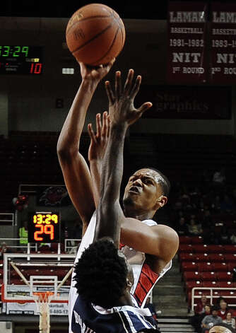 Lamar player Rhon Mitchell, #10, puts it up for two during the Lamar University mens basketball game against Oral Roberts University at the Montagne Center on March 2, 2013.  Oral Roberts won over Lamar 68 - 50. Photo taken: Randy Edwards/The Enterprise