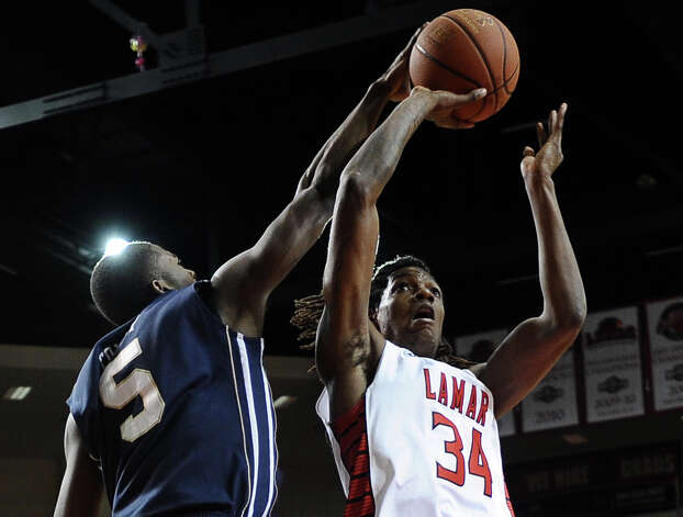 Lamar player Amos Wilson, #34, puts it up for two during the Lamar University mens basketball game against Oral Roberts University at the Montagne Center on March 2, 2013.  Oral Roberts won over Lamar 68 - 50. Photo taken: Randy Edwards/The Enterprise