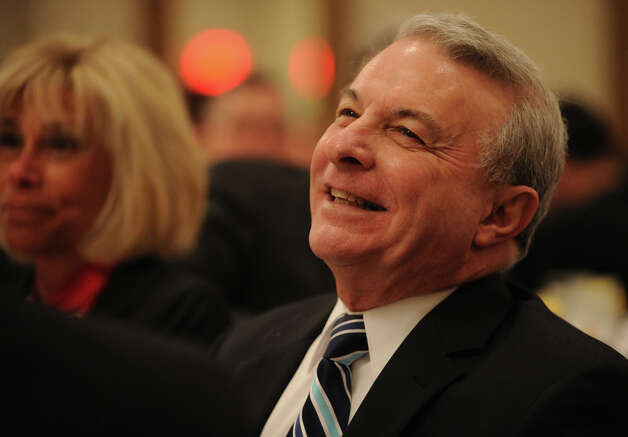 Michael Bisciglia, retiring vice president of the St. Vincent's Medical Center Foundation, is lauded at the annual SWIM Across the Sound fundraising breakfast at the Holiday Inn in Bridgeport, Conn., on Wednesday, March 6, 2013. Photo: Brian A. Pounds / Connecticut Post