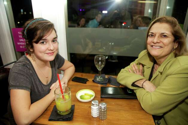 Elizabeth Farrell and Rebecca Galvan are finishing off drinks at The Fruteria.
