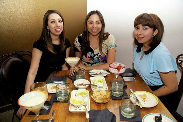 Sonya Quintanilla, Veronica Santos, and Monica Barrientos are sipping on drinks and finishing up dinner at The Fruteria.