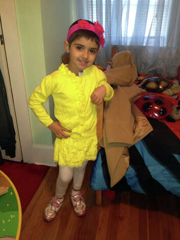 Four--year-old Mackenzie Newsome dresses up in her Danbury home.  She lost her battle with stage 4 cancer on Tuesday. Photo: Contributed Photo / The News-Times Contributed