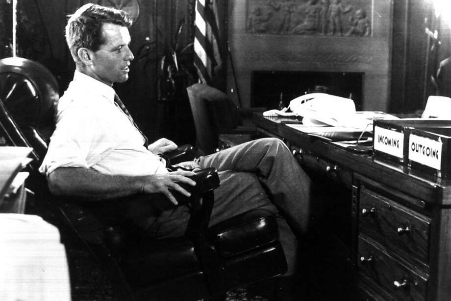 "LOA05:KENNEDY:LOS ANGELES,CALIFORNIA,4JUN98 - 1968 FILE PHOTOGRAPH - Robert F. Kennedy sits at his desk at the Justice Department in this 1968 file photograph.  Robert Kennedy was shot in Los Angeles  June 5 1968, and died the following day. The 30th anniversary of his assassination is this year.  ""Robert F. Kennedy: A Memoir,"" a documentary on Kennedy, will be telecast on the Discovery Channel in the United States June 7.   BW ONLY  fsp/Photo Courtesty JFK Library/Discovery Channel REUTERS Photo: Jfk Library"