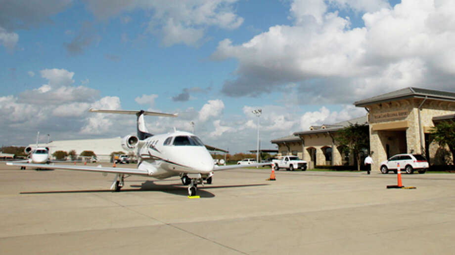 Charter air-travel business planes at the Sugar Land Regional Airport. Photo: Julio Cortez, . / Houston Chronicle