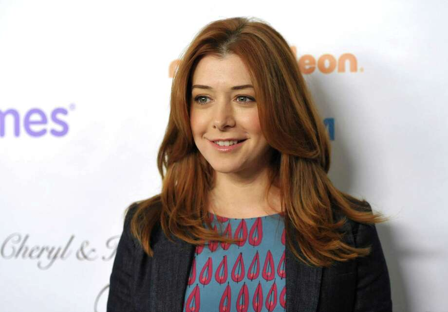 "FILE - This Dec. 7, 2012 file photo shows actress Alyson Hannigan from the CBS comedy, ""How I Met Your Mother,"" at the March of Dimes Celebration of Babies  in Beverly Hills, Calif.  A judge has ordered a New Hampshire man to stay away from Alyson Hannigan and refrain from posting about the actress for the next three years. (Photo by John Shearer/Invision/AP, file) Photo: John Shearer"