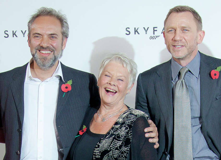"FILE - This is a Thursday, Nov. 3, 2011. file photo of Film  Director Sam Mendes, with actors Dame Judi Dench and Daniel Craig at the photo call for the new James Bond film titled Skyfall, at a central London restaurant venue.  Never say never again? Sam Mendes says he won't be directing the next James Bond film — but may work on the series again in future. In comments published Wednesday March 6, 2013  by movie magazine Empire, Mendes said he was honored to have been part of the Bond family, ""and very much hope I have a chance to work with them again."" (AP Photo/Joel Ryan, File) Photo: Joel Ryan"