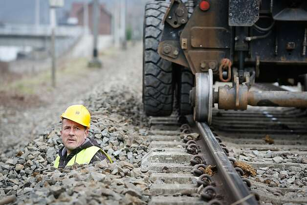 Runaway prevention: A hard-hat in Profondeville, Belgium, pokes his head out of the railroad bed while working on what will be the first ETCS (European Train Control System) line. The new system will automatically stop a train that neglects a red light or exceeds the maximum speed limit. Photo: Bruno Fahy, AFP/Getty Images