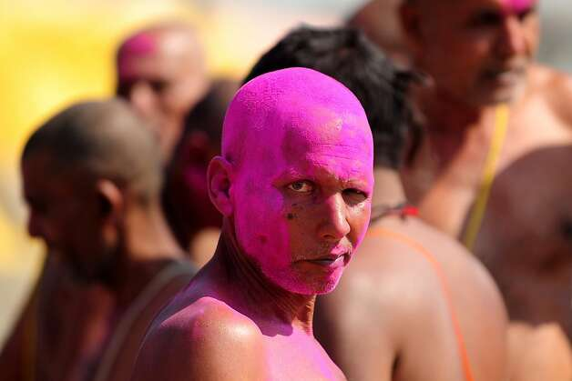 Fuchsia facial: A Bihari Hindu priest smeared with colored powder completes a ritual at the Sangam, the confluence of the rivers Ganges, Yamuna and mythical Saraswati in Allahabad, India. Photo: Sanjay Kanojia, AFP/Getty Images