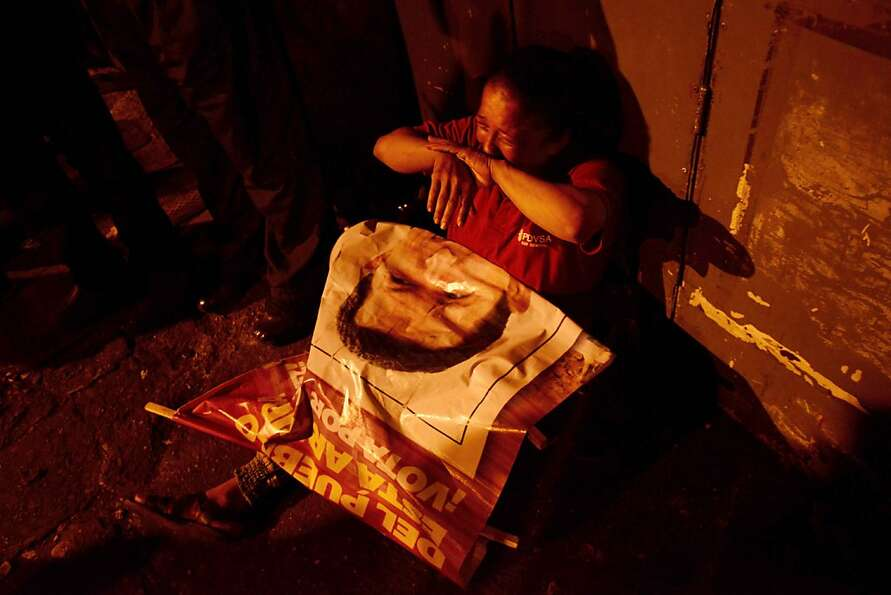 Mourning el presidente: A supporter of Hugo Chavez weeps outside the Military Hospital