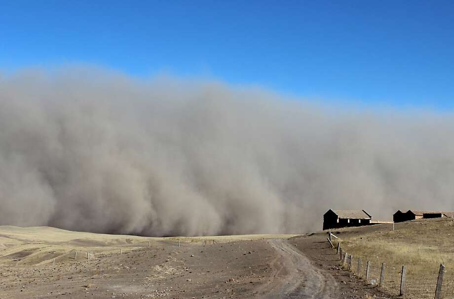 TOPSHOTS This picture taken on March 5, 2013 shows a sandstorm hitting the town of Shandan Horse Ranch in Zhangye, northwest China's Gansu province. According to eyewitnesses, large amounts of black dust and sand were pushed by strong winds, resembling a wall rolling across the horse farm from the west. CHINA OUT     AFP PHOTOAFP/AFP/Getty Images Photo: Afp, AFP/Getty Images