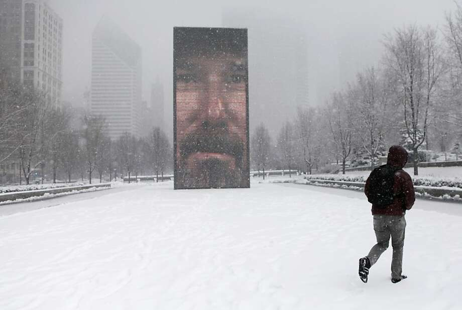 Big Brother is watching you, Chicago: A surveilled pedestrian strolls through Chicago's Millennium Park during a snowstorm. Photo: Kiichiro Sato, Associated Press