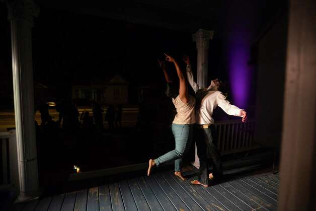 Dancers Priya Jag and Stephan Gaeth let loose on the front porch of Jump-Start company member Dino Foxx. His monthly parties allow artists to meet and collaborate. Photo: Billy Calzada, San Antonio Express-News / San Antonio Express-News